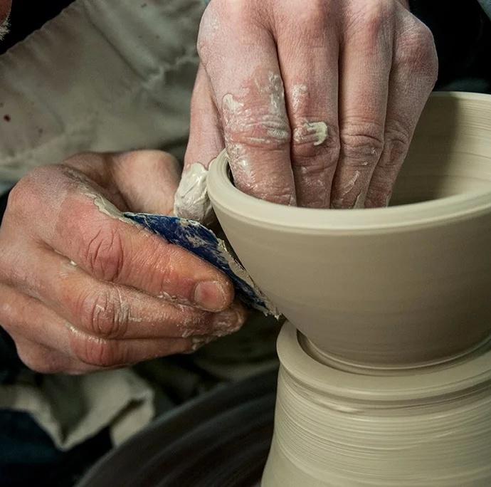 hands working clay